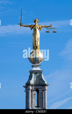 The statue of Lady Justice or the Scales of Justice above the Central Criminal Court, Old Bailey, London. - Stock Photo