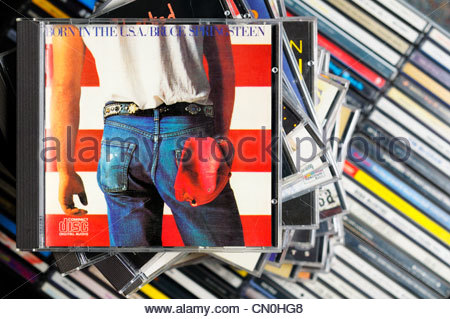 Bruce Springsteen Born in the USA album on a stack of CD cases, England - Stock Photo