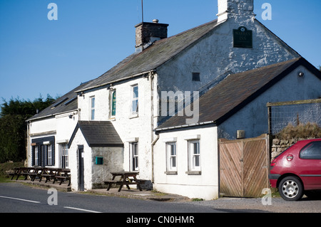 Warren House Inn,the most famous Inn on Dartmoor.  The Warren House Inn is near the Bronze age settlement remains - Stock Photo