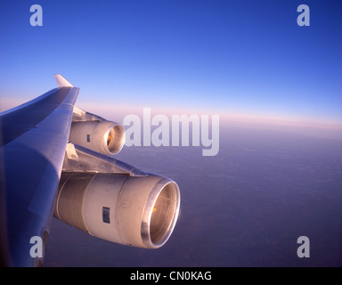 View of wing and engines from inside Boeing 747-400 aircraft - Stock Photo