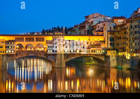 Europe, Italy, Florence, Ponte Vecchio over the Arno River at Dusk - Stock Photo