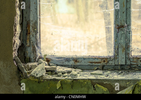 Old wooden window in abandoned building - Stock Photo