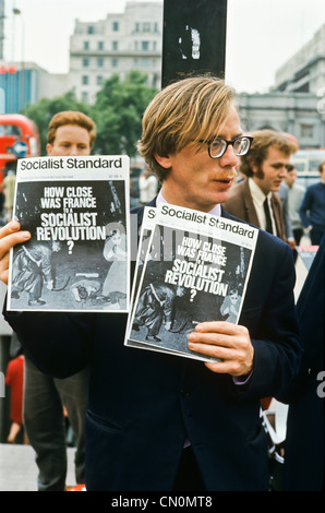 July 1968,Socialist Standard newspaper street vendor,vintage image, London,UK,Great-Britain,Europe May 1968 French - Stock Photo