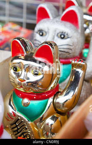 Golden beckoning Cat for sale in China town San Francisco California USA - Stock Photo