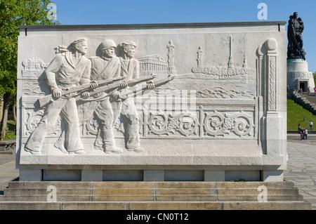 Soviet War Memorial (Treptower Park). The bas-relief, the defense of Leningrad. - Stock Photo