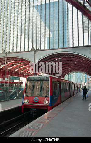 Docklands Light Railway DLR station with train at Canary Wharf. London. England. - Stock Photo