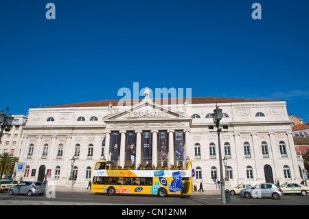 Sightseeing tour bus passing Teatro Nacional de Dona Maria II at Rossio square Lisbon Portugal Europe - Stock Photo
