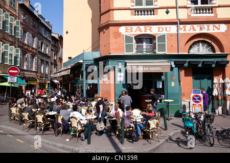 People sitting outside at Bar du Matin, Toulouse, South of France - Stock Photo