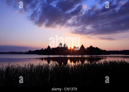Trakai Island Castle on the shores of Lake Galvé in Trakai, Lithuania - Stock Photo