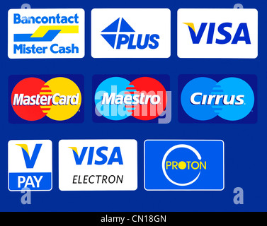 Sign showing trademark logos of credit cards on automated banking machine / cash dispenser of KBC bank, Flanders, - Stock Photo
