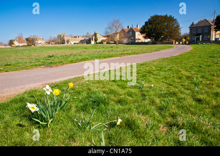 Houses around the large open common at Broughton Gifford, Wiltshire, England, UK - Stock Photo