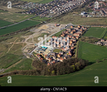 Aerial view of new houses under construction on green belt land in Yorkshire - Stock Photo