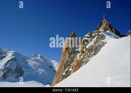The summit of Aiguille du Midi with Mont Blanc to the left. - Stock Photo