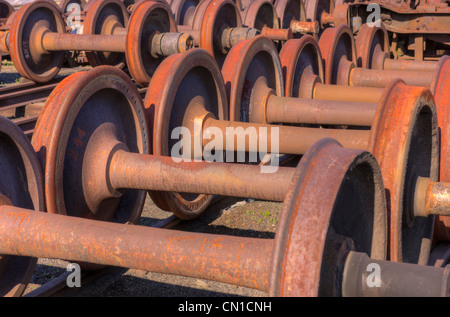 Rusted railroad car wheelsets at the Steamtown National Historic Site in Scranton, Pennsylvania. - Stock Photo