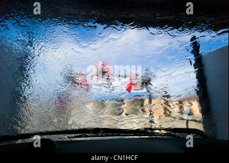 View through the windshield of an automobile in an automated car wash. - Stock Photo