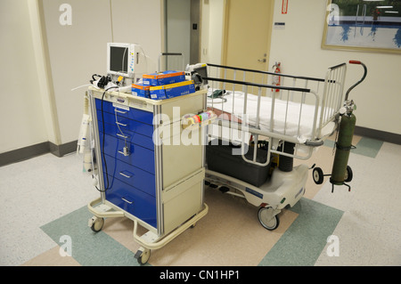 Pediatric surgical cart in a hospital corridor. - Stock Photo