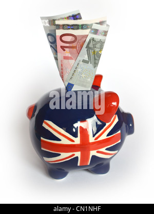 Union jack flag piggy bank with Euro notes stuffed in. - Stock Photo