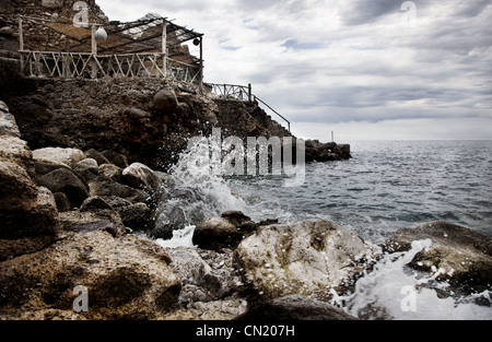 Waves crashing against rocks, Majorca, Spain - Stock Photo