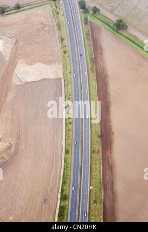 Aerial view of motorway, UK - Stock Photo