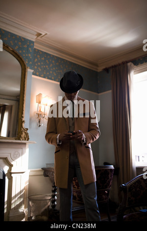 Smartly dressed man in hotel room - Stock Photo