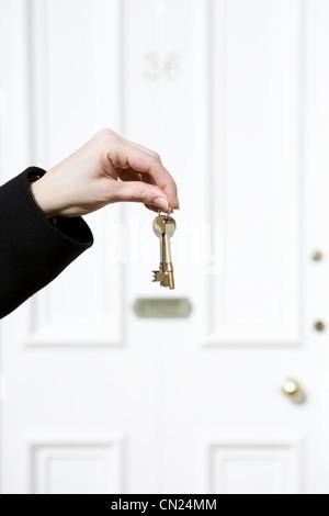 Woman holding house keys - Stock Photo