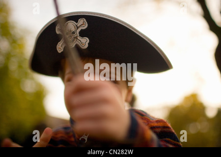 Young boy dressed as pirate - Stock Photo