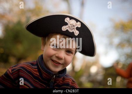Boy dressed up as pirate - Stock Photo