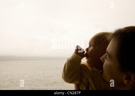 Mother holding toddler son, close up - Stock Photo
