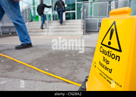 a trip hazard sign by a hose pipe outside the keighley. Black Bedroom Furniture Sets. Home Design Ideas