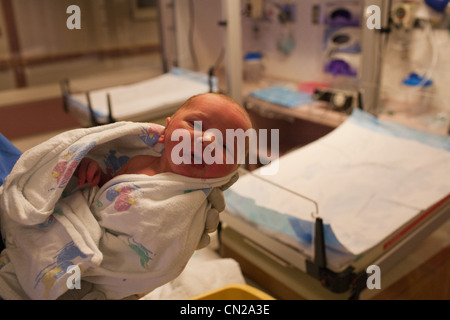 Newborn baby boy in hospital - Stock Photo
