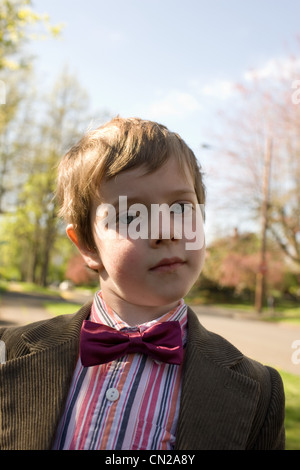 Portrait of boy wearing bow tie and jacket - Stock Photo