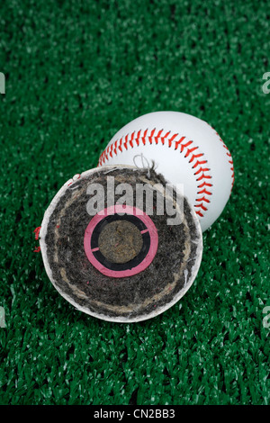 Cross section of a Rawlings Major league baseball. Has a cork center encased in two rubber layers, layers of yarn, - Stock Photo