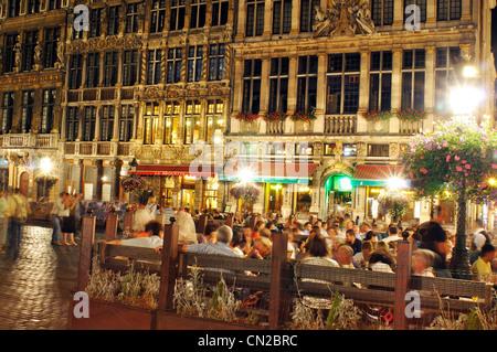 Belgium, Brussels, Grand Place Square, Restaurant at Night - Stock Photo