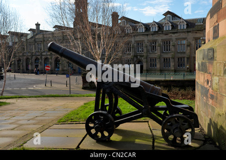 Canon situated outside the Citadel Carlisle City center with Railway Station in background,  Cumbria, United Kingdom - Stock Photo