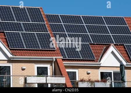 solar panels on house roof - Stock Photo