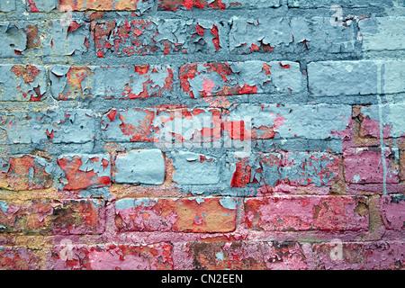 Colorful Peeling Paint on Brick Wall - Stock Photo