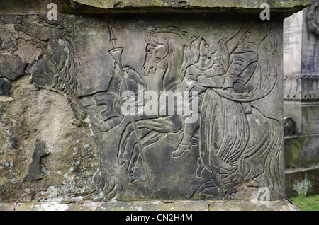Detail from a weathered and damaged frieze on a monument in the Glasgow Necropolis. - Stock Photo