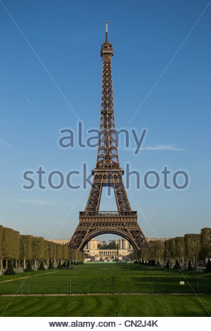 The Eiffel Tower from the Champ de Mars on a cloudless, spring morning - Stock Photo