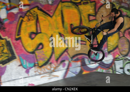 This is an image of a freestyle bmx bike rider performing a stunt. - Stock Photo