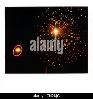 Instant film photograph of firework display - Stock Photo