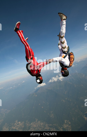 Skydivers freeflying over Locarno, Tessin, Switzerland - Stock Photo