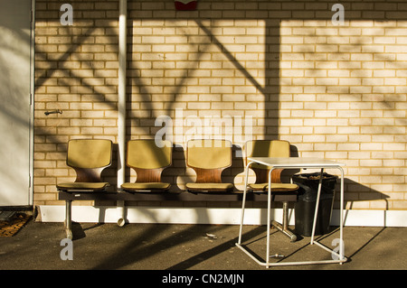 Row of chairs outside building - Stock Photo