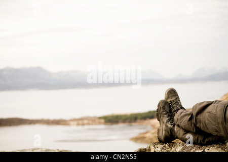Man resting by lake - Stock Photo