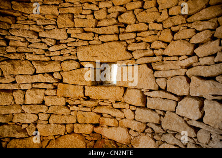 Square window in stone wall - Stock Photo