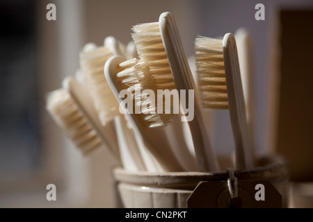 Toothbrushes in pot - Stock Photo