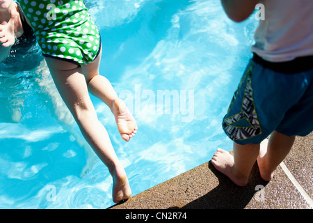 Young Girl Jumping Into Pool Stock Photo Royalty Free