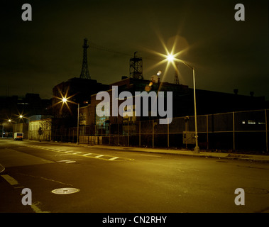 Street and Navy Yard at night, Brooklyn, New York, USA - Stock Photo