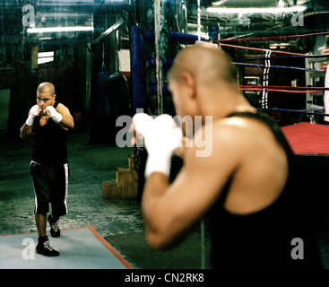 Man shadowboxing in Brooklyn boxing gym - Stock Photo
