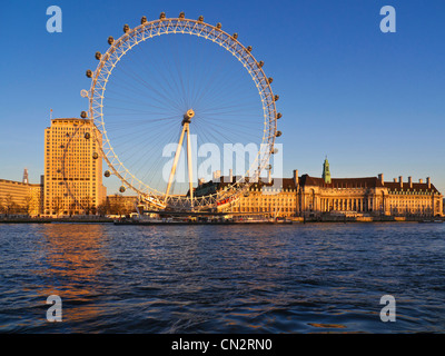 London Eye County Hall and Shell HQ South Bank from Westminster Pier Victoria embankment at sunset Westminster London - Stock Photo