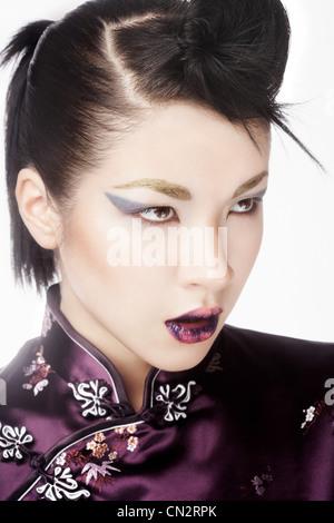 Young woman wearing cheongsam with fashion make up - Stock Photo